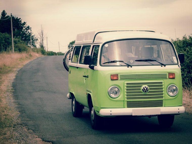 Green minivan on the road