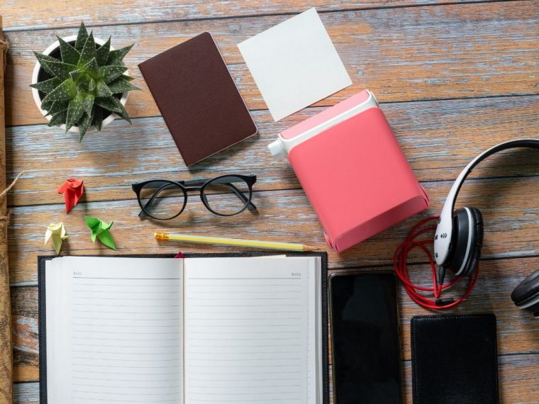 Wood onwith glasses and a notepad on