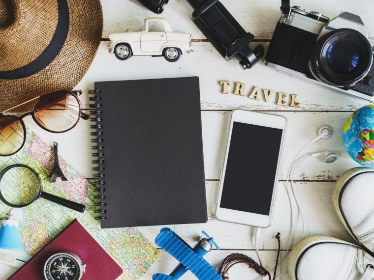 Notepad, phone, hat and other travel items